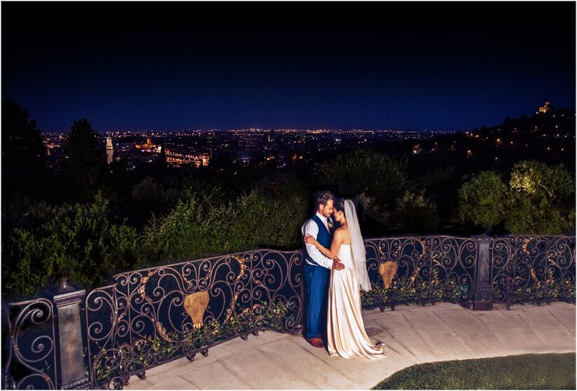 Night photography overlooking Verona, Italy with bride and groom