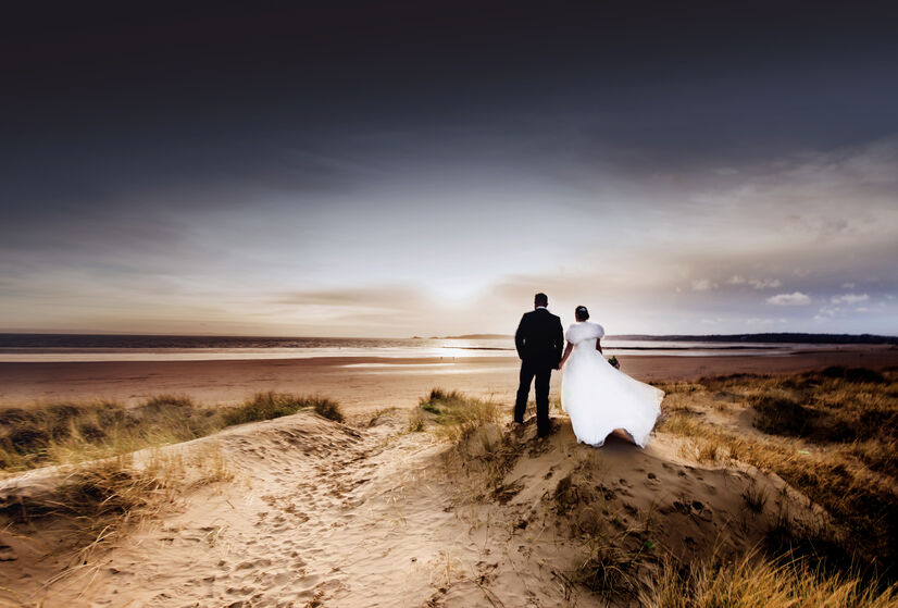 Bride and Groom over looking Mumbles, image by Karl Baker photography, Swansea
