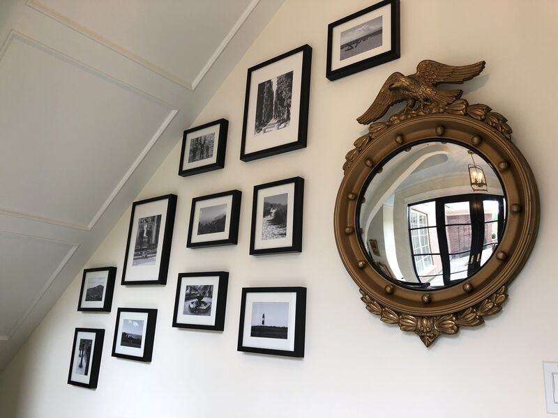 Gallery wall with ornate gold mirror