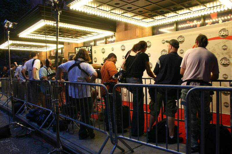 Red carpet with photographers at event at New World Stages