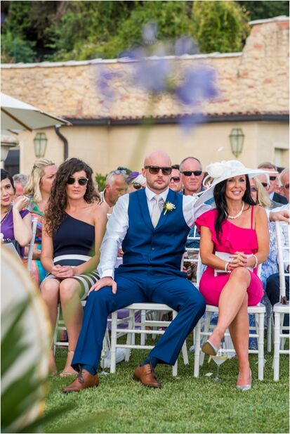 wedding guests seated at outdoor ceremony in Verona Italy