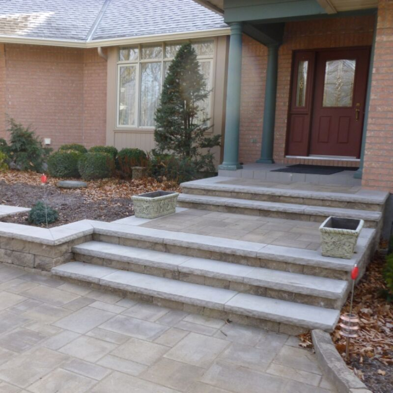 Home entrance way with custom built stone steps and landing