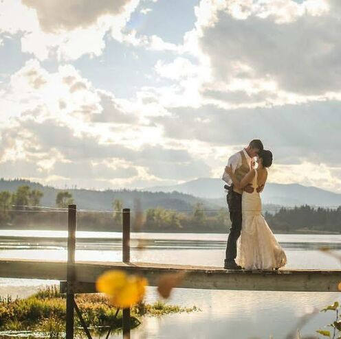 newly married couple embracing on a dock on Lake Pend Oreille