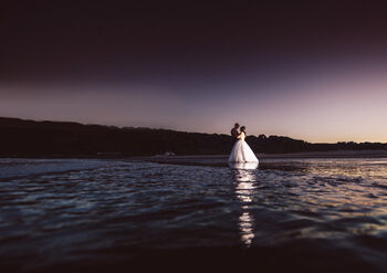 Oxwich bride and groom on beach with interfit photographic uk lights