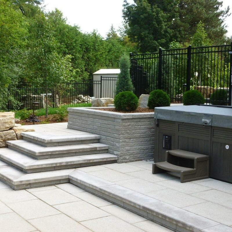 Backyard custom built stone steps and landing