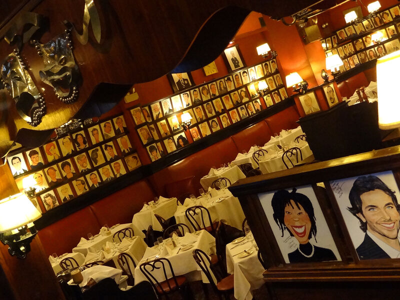 Interior dining area Sardi's the comedy and tragedy theater masks
