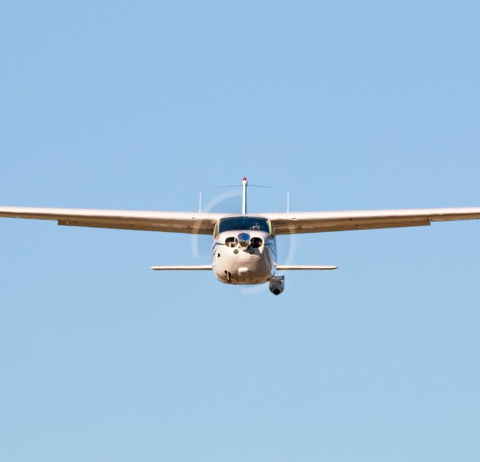 A Cessna Cardinal with a pipeline inspection camera pod attached.