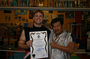 "Jerry earning his Kru certificate from Grandmaster Thohsaphon ""Master Toddy"" Sitiwatjana"