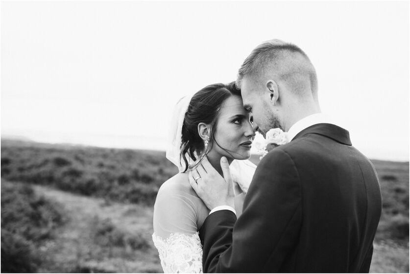 Bride & Groom on Cefyn Bryn, Gower. By Karl Baker photography