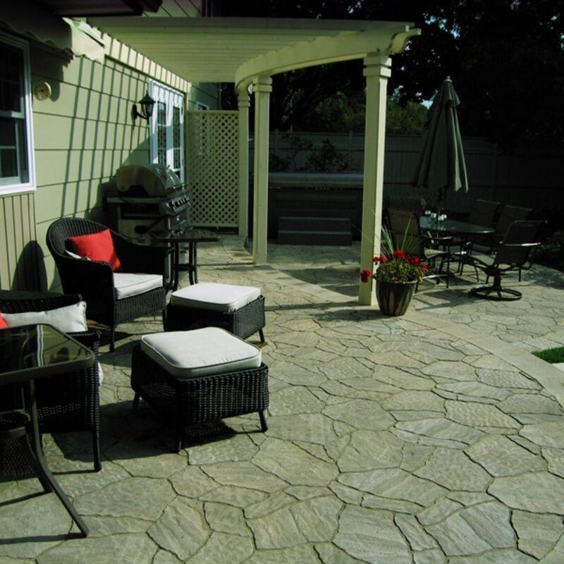 Backyard patio custom designed with unit pavers