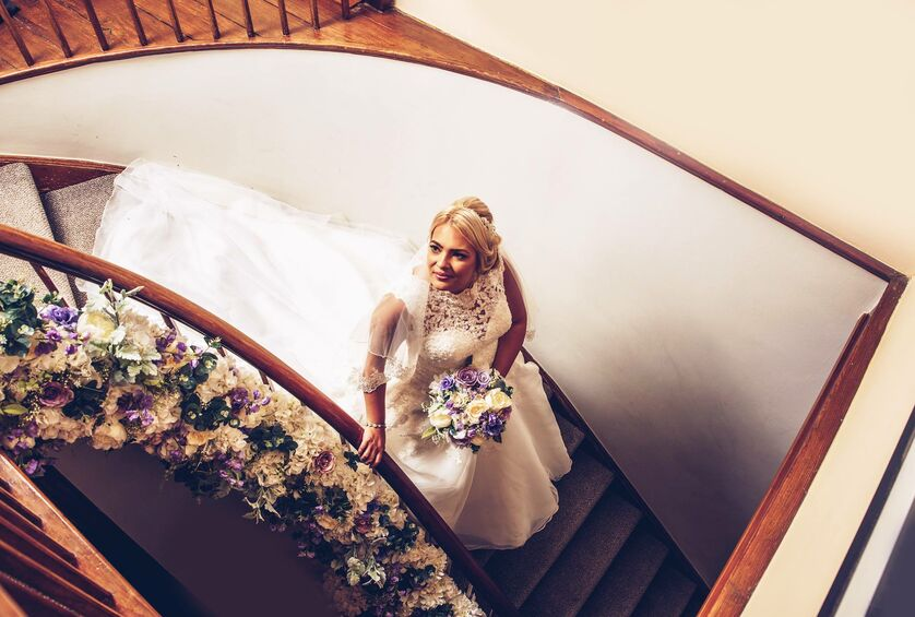 Bride on stairs at Fairyhill, Gower