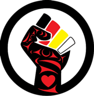 Raised fist in First Nations design. The colours representing the people of the world. Black, red, yellow, & white.