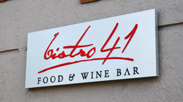 A white LED sign with Bistro 41 in red font.