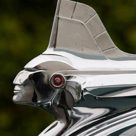 This is a classic piece of mid-century American car decoration based on a Pontiac Indian's mohican haircut and profile from 1951