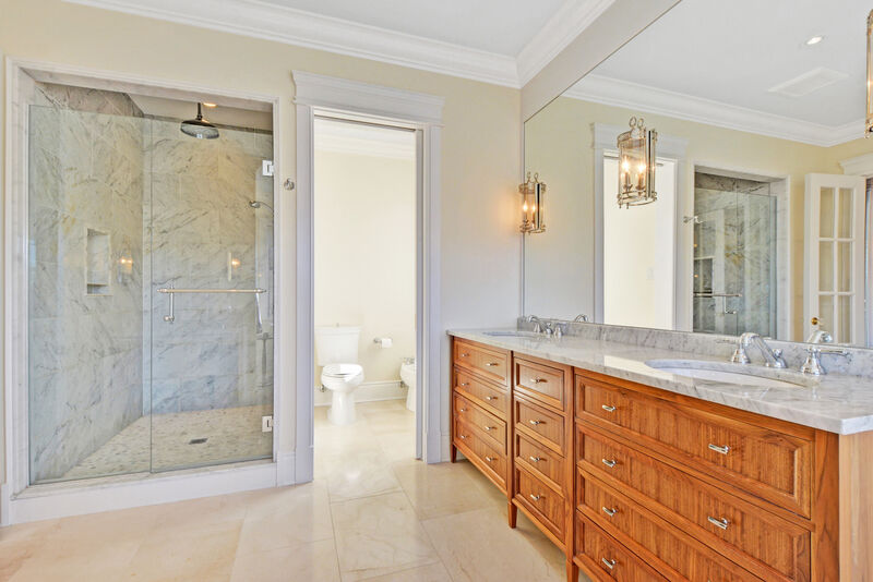 Transitional traditional style mater bathroom with custom walnut vanity, and elegant walk in shower