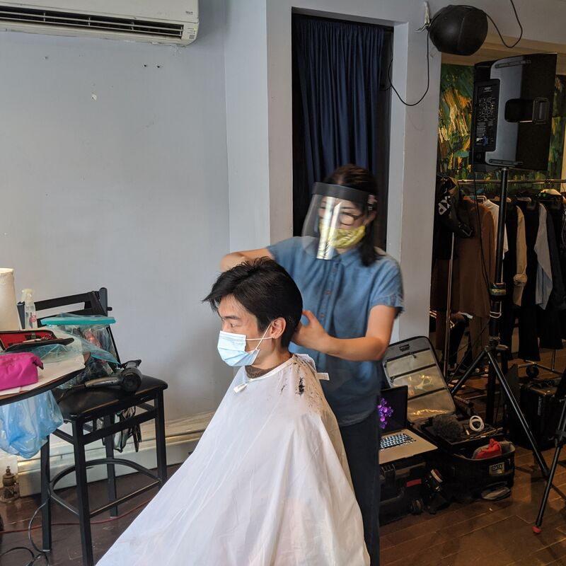 Hairdresser with talent on fashion shoot.
