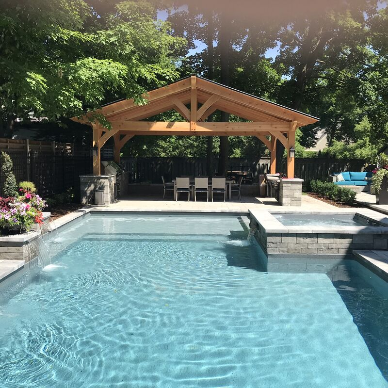 Custom built backyard swimming pool with water features and whirlpool