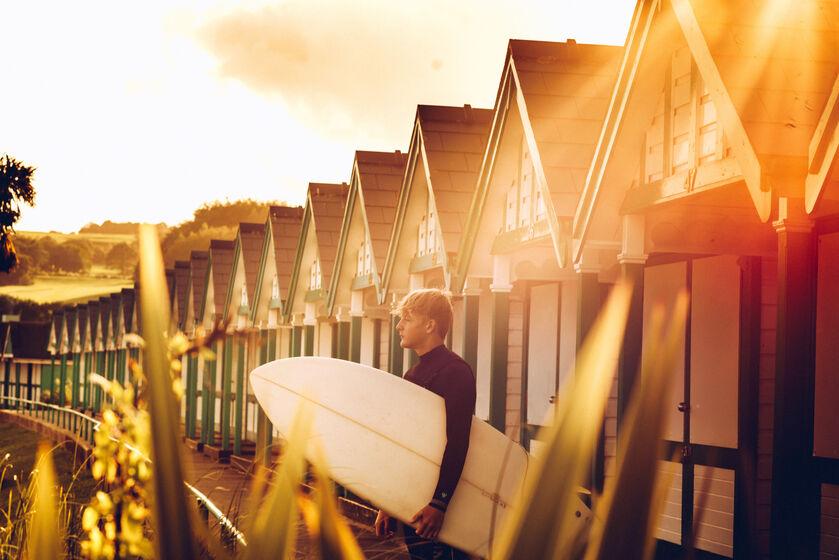 surfer in Langland bay Gower