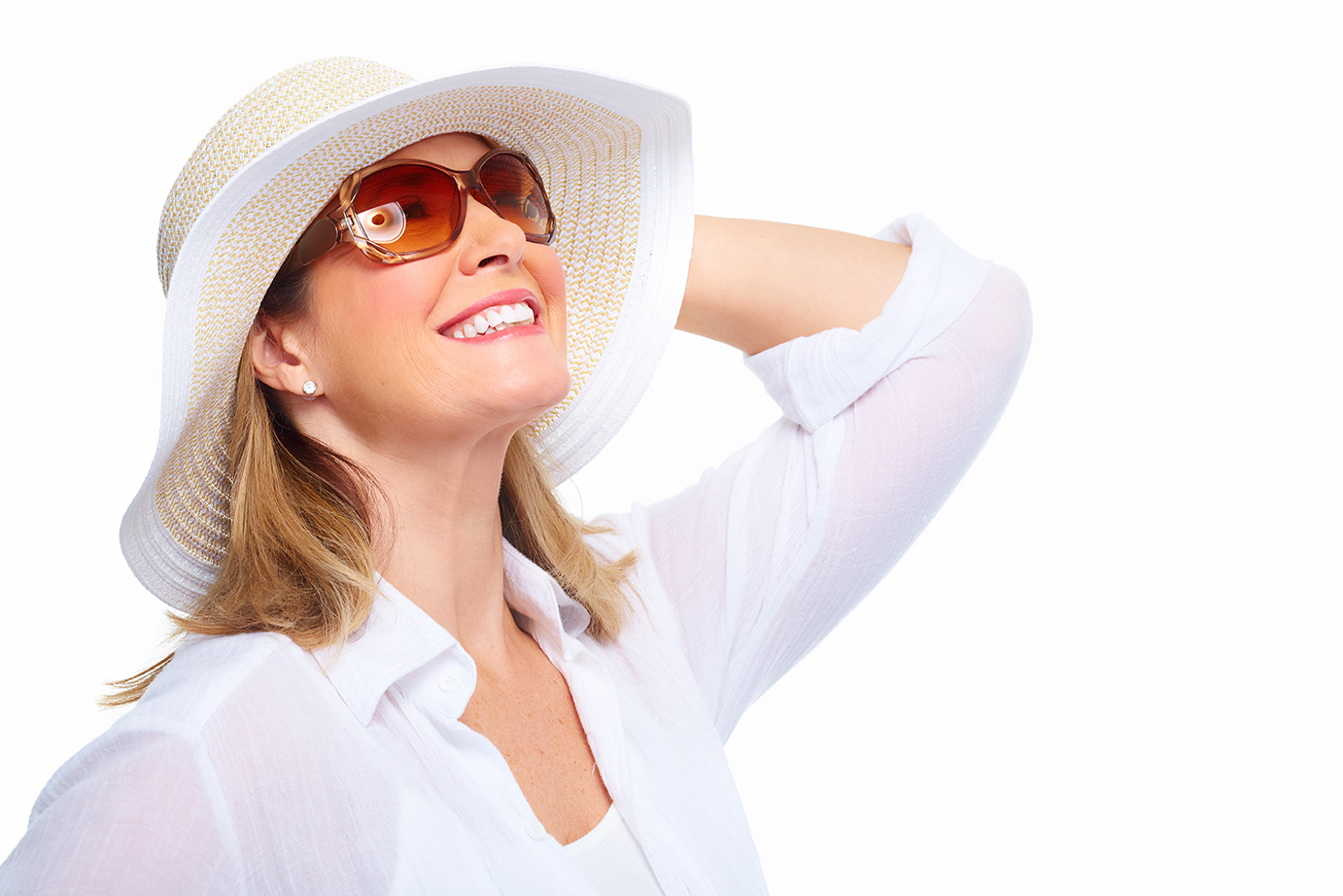 A smiling woman with sunglasses and large sun hat.