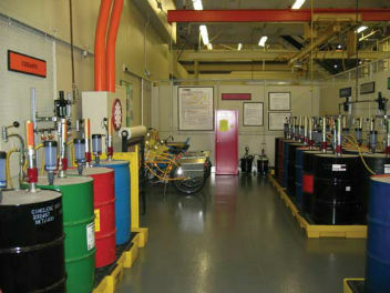 Image showing barrells of lubricant properly stored in a lubricant room, this helps to reduce lubricant contamination.