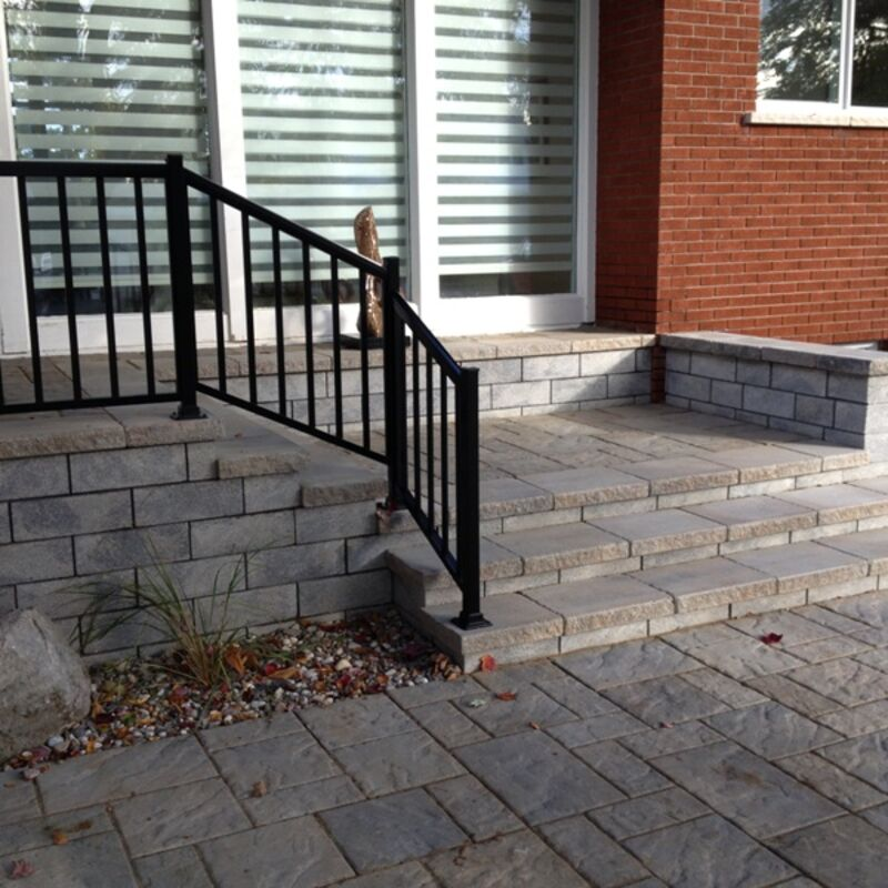 Stone built steps leading to the front entrance of a home