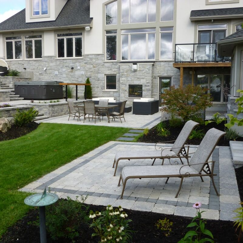 Backyard living area with patio built using unit pavers