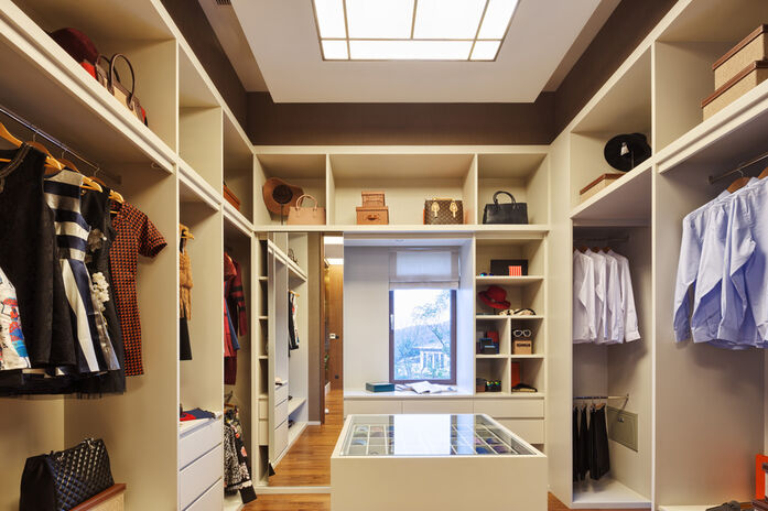 A decluttered wardrobe/closet, tidy and clutter free