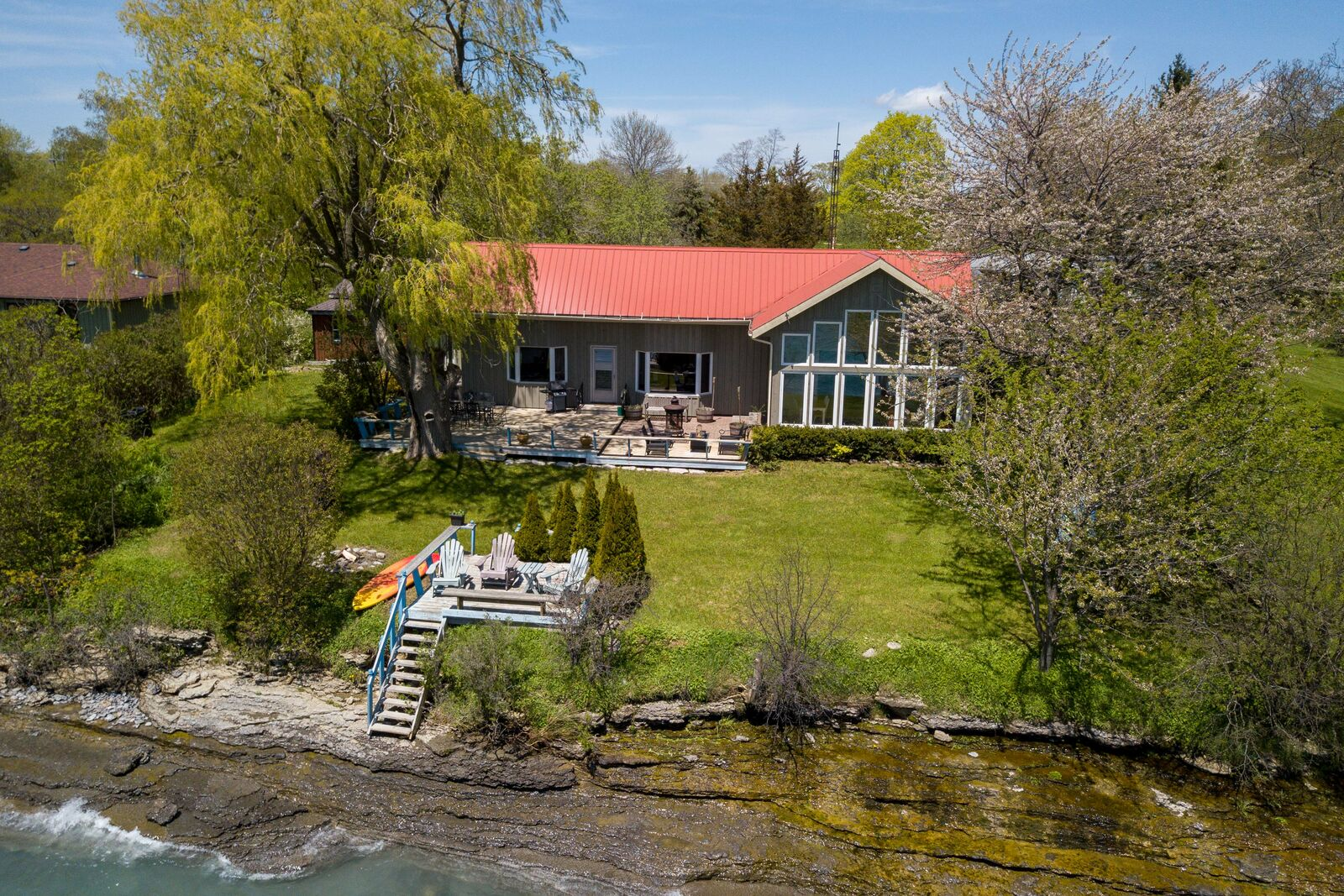 Aerial view of a waterfront cottage on Lake Ontario in Wellington ON