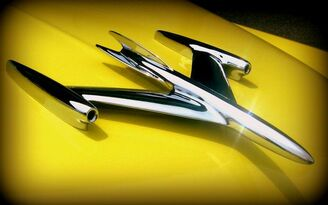 This is a midcentury Space Age Rocket 88 hood ornament in the shape of a rocket jet