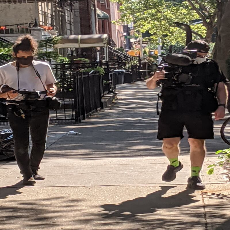 Cameraman and assistant on location in Brooklyn.