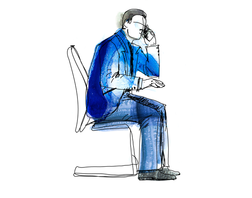 Man in chair conducting a monthly telephone review with a small business client.