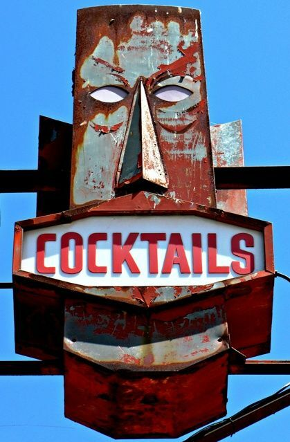 This is a great tiki bar sign with a neon light center from midcentury period