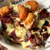 Loaded hash browns with cheese & bacon