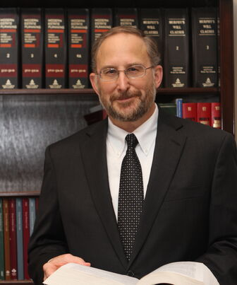 "Attorney Richard W. ""Rick"" Rousseau, Veteran & Military Lawyer in his office at Criss & Rousseau LLP Harker Heights, Central Texas."
