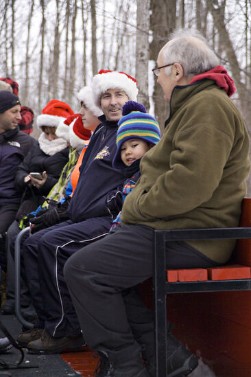 Sitting for the sleigh ride at Thomas Tree Farm