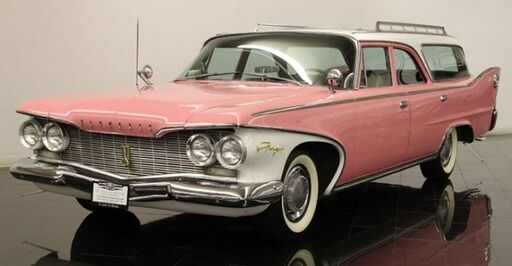 This is a pink and white 60's chrome trimmed Plymouth Sport Suburban Wagon with white wall tyres