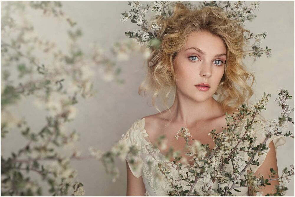 portrait of a blonde girl in white flowers and vintage dress done in painterly style