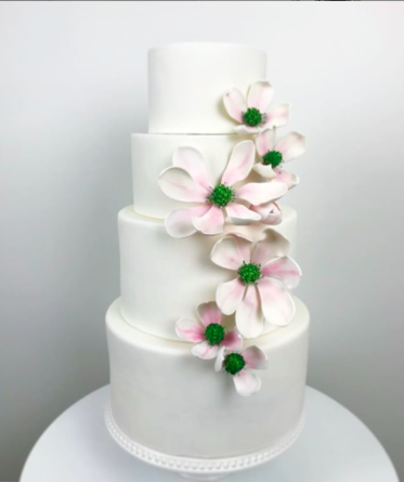 Original white wedding cake with orchid flowers