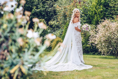wedding dress photography in the garden during bridal preperations