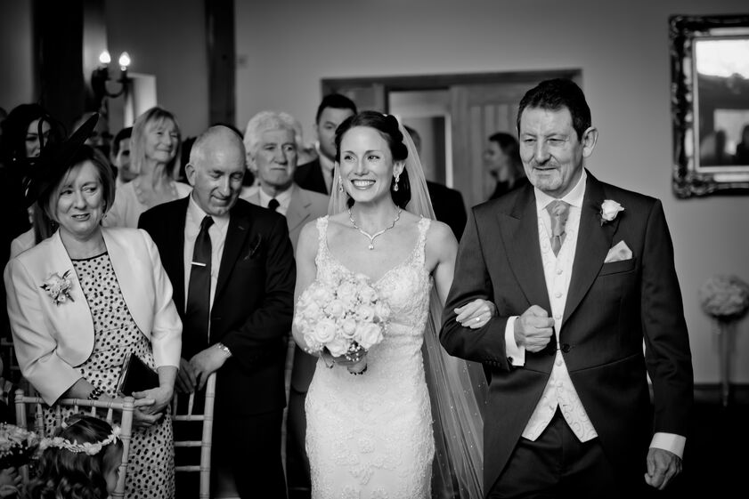 bride walking down the aisle at Oldwalls gower wedding