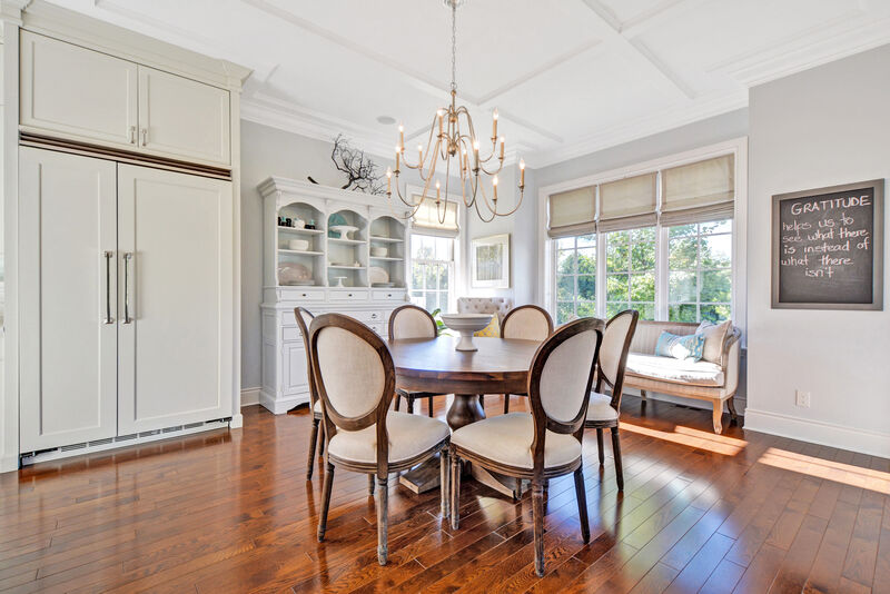 transitional eat-in kitchen dining area with vintage french style dining chairs and a round table
