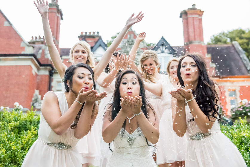confetti shot of brides with bridesmaids in Coed Y Mwstwr bridgend