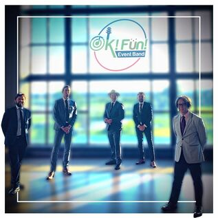 Promotional photo for Vancouver Based Cover Band OK FUN. There are five gentleman in trendy suits standing in front of the swanaset Bay resorts main ball room window.