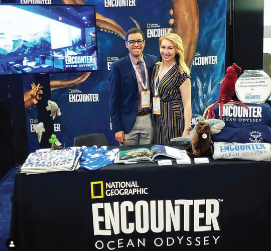Staff members at booth featuring National Geographic Encounter