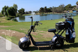 Side view of electric single rider golf cart with golf bag