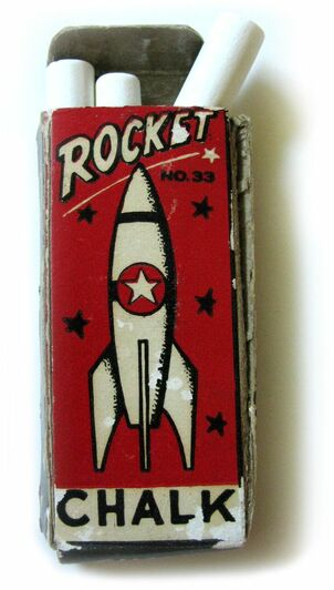 A box of children's chalk sticks featuring a vintage space age graphic drawing of a rocket