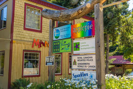 Store frontage and signs. Woodstone Manor supports local on Galiano Island.