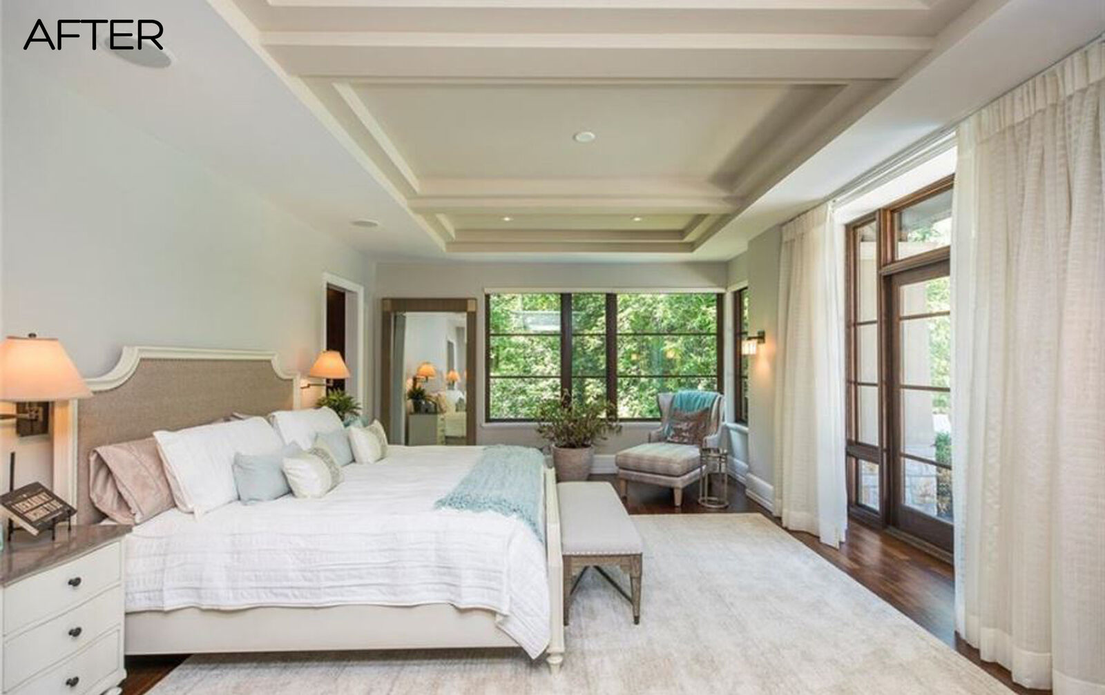 elegant master bedroom redesign with mint sage green accents, chaise loung, large windows and bedside sconces