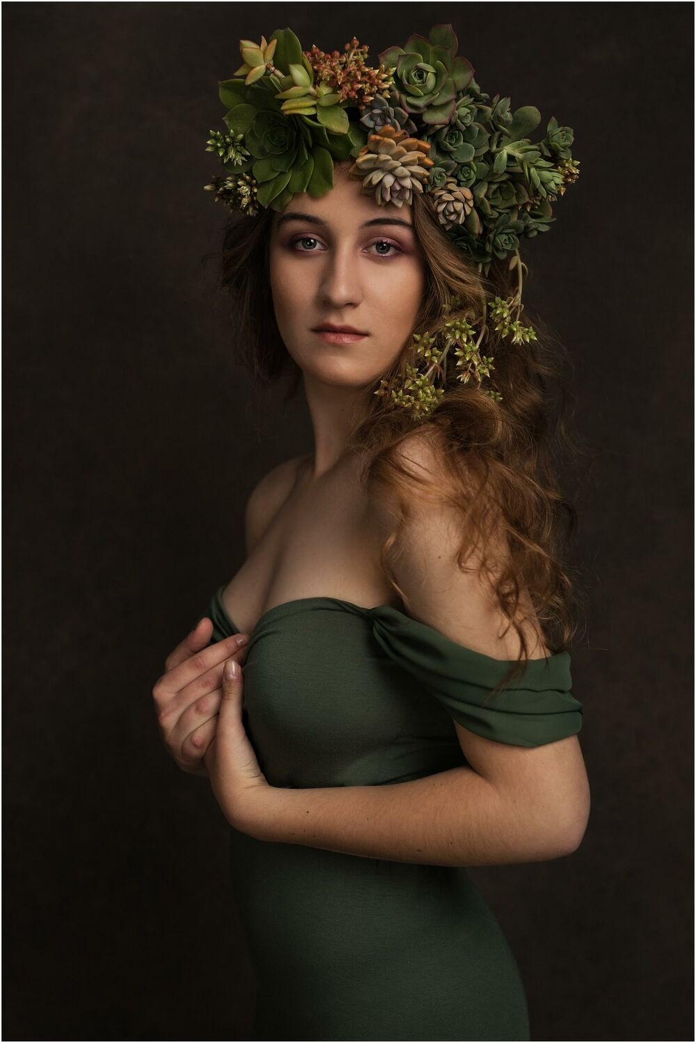 portrait of a girl in a succulent crown in a vintage painterly style