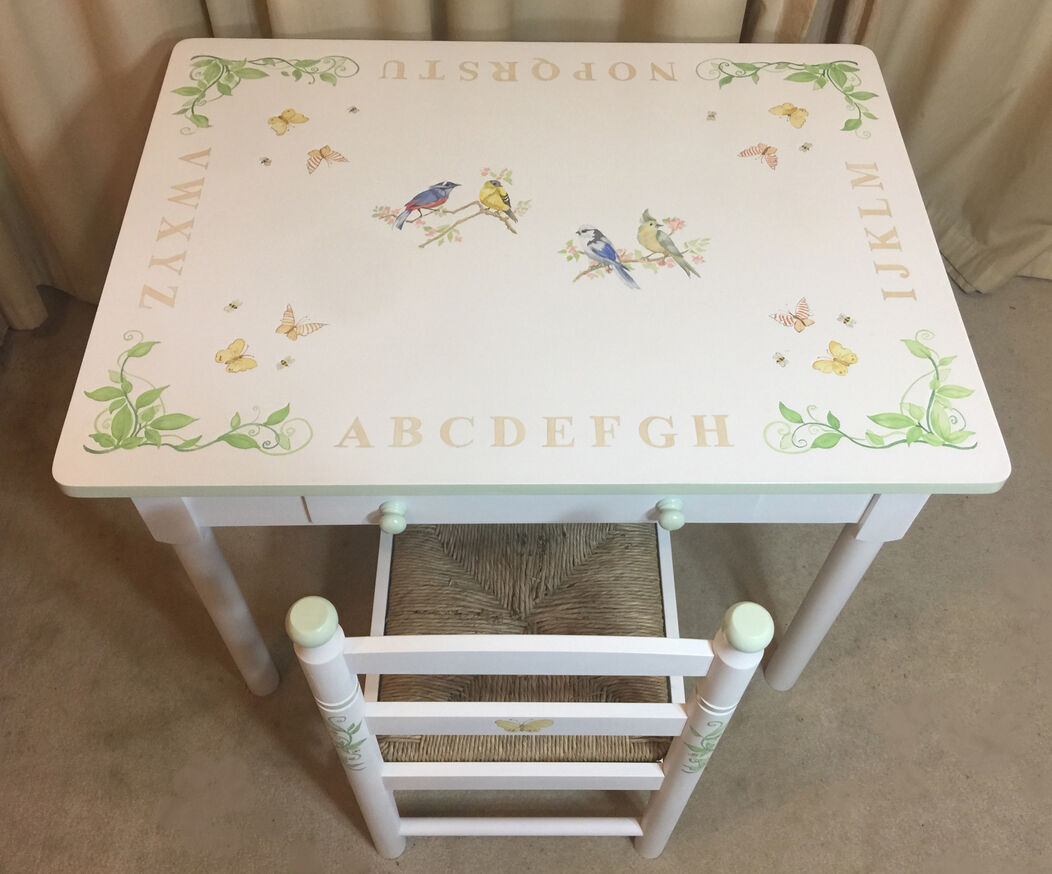 Hand painted child's table with alphabet and birds